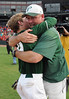 Pelham head coach Sean Anderson hugs player Justin Anderson after the game in the 6A AHSAA state championship finale won by Pelham 1-0 over Hewitt-Trussville at Riverwalk Stadium in Montgomery, Ala., May 18, 2013.  By David Bundy