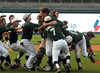 Pelham players rush to pitcher Jack Pierce after the game in the 6A AHSAA state championship finale won by Pelham 1-0 over Hewitt-Trussville at Riverwalk Stadium in Montgomery, Ala., May 18, 2013.  By David Bundy