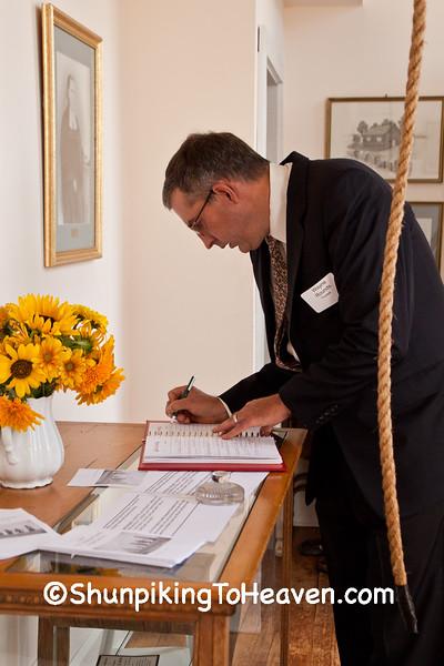 Board Member Wayne Rounds Signing Guest Book