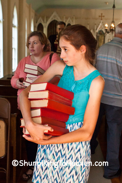 Collecting Hymnals After the Annual Service