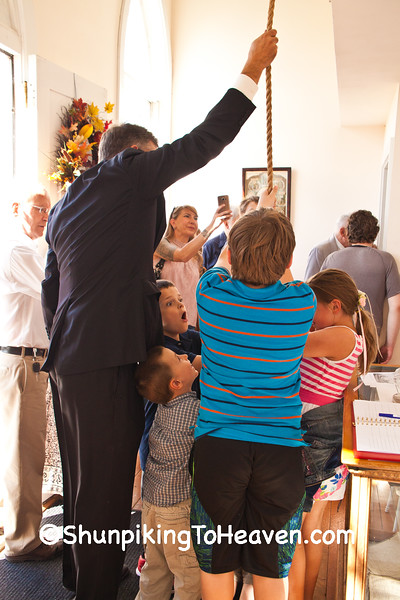 Board Member Wayne Rounds Helping Children Ring the Church Bell
