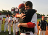 Huntsville pitcher Daniel Kroger hugs coach Mark Mincher after the game as Huntsville plays Baldwin County in the 6A Alabama High School Athletic Association Baseball Championships at Riverwalk Stadium in Montgomery, Ala., Friday, May 20, 2011. Huntsville won the game 10-2 and won the championship. By David Bundy