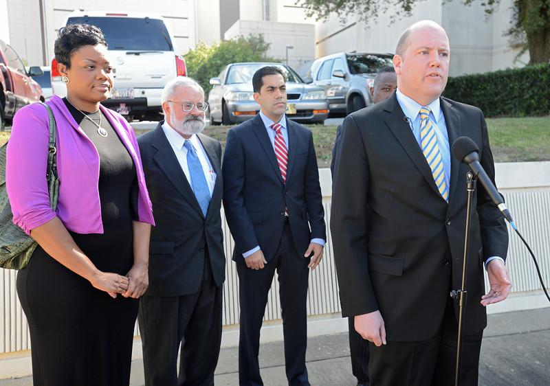 Institute for Justice lawyers Bert Gall, Dick Komer, and Arif Panju, along with client Tequila Rogers and Alabama Black Alliance for Educational Options State Director John Hilliard, speak during a press conference on school choice held by the Institute for Justice at the courthouse in Montgomery, Ala., Thursday, Oct.10, 2013. By David Bundy