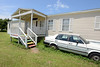 A trailer home used by Jamaican students in Foley, AL. J1 program international students-July, 2013. By David Bundy