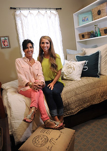 Aug. 13, 2012 (9:30 AM CST) -- Auburn, AL, U.S.A Auburn University freshman Griffin Knight of Madisonville, Texas, left, and her mom Dawn pose in Griffin's dorm room after they explore the room's decor for the first time as she arrives on campus Monday, Aug. 13, 2012. The room was decorated by local interior design and decorating firm Moxii, and features fabrics, furniture and accessories chosen by Knight.  Photo by David Bundy, Freelance