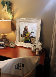 Aug. 13, 2012 (9:30 AM CST) -- Auburn, AL, U.S.A Auburn University freshman Griffin Knight of Madisonville, Texas, is reflected in a desktop mirror as she poses in her freshly decorated dorm room after she arrives on campus for the first time Monday, Aug. 13, 2012. The room was decorated by local interior design and decorating firm Moxii, and features fabrics, furniture and accessories chosen by Knight.  Photo by David Bundy, Freelance