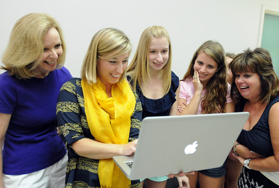 Aug. 5, 2012, 9:30 AM -- Auburn, AL, U.S.A -- Katherine Bailey, second from left, co-owner of Moxii, an interior design and decor firm in Auburn, Ala., shows moms Judy Fortin-LaLone, left, and Lynn Floum, right, their daughters' dorm room before it was decorated as the daughters, Robin LaLone, center left, and Cara Floum, look at the images on a computer before seeing their Auburn University dorm for the first time Sunday, Aug. 5, 2012, in Auburn, Ala.  Photo by David Bundy, For USA TODAY