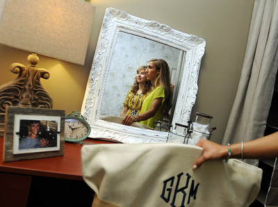 Aug. 13, 2012 (9:30 AM CST) -- Auburn, AL, U.S.A Auburn University freshman Griffin Knight of Madisonville, Texas, right, and interior design firm Moxii co-owner Betsy Stark are reflected in a mirror as Knight explores her dorm room decor for the first time as she arrives on campus Monday, Aug. 13, 2012. The room was decorated by Moxii, and features fabrics, furniture and accessories chosen by Knight.  Photo by David Bundy, Freelance