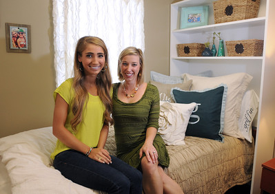 Aug. 13, 2012 (9:30 AM CST) -- Auburn, AL, U.S.A Auburn University freshman Griffin Knight of Madisonville, Texas, left, and Katherine Bailey, co-owner of local interior design firm Moxii, pose in Griffin's dorm room after they explore the room's decor for the first time together as she arrives on campus Monday, Aug. 13, 2012. The room was decorated by Moxii designers and features fabrics, furniture and accessories chosen by Knight.  Photo by David Bundy, Freelance