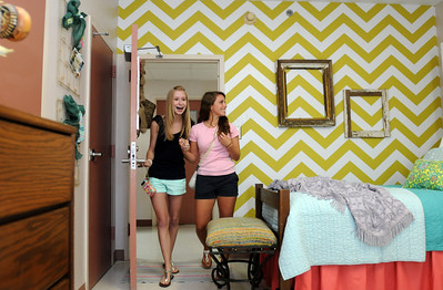 Aug. 5, 2012, 9:30 AM -- Auburn, AL, U.S.A -- Dorm roommates Robin LaLone, left, and Cara Floum, Auburn University freshmen from Atlanta, Ga., see their dorm room for the first time as decorated and designed by Moxii, an Auburn interior design and decor business, Sunday, Aug. 5, 2012, in Auburn, Ala.  Photo by David Bundy, For USA TODAY
