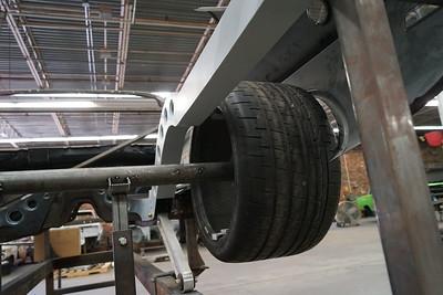 rearward in wheel well