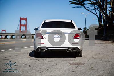 MercedesE300_White_7TKD487_Logo_4000Pixel-1