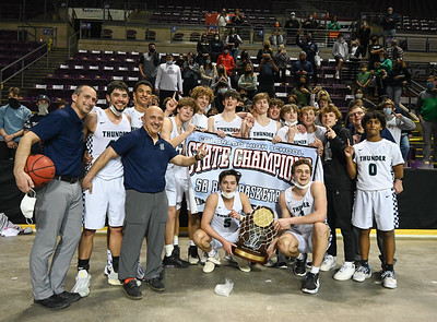 The Thunderridge Boys Basketball team celebrate their 68-59 5A State Championship victory over George Washington Saturday night at the Broadmoor World Arena in Colorado Springs.