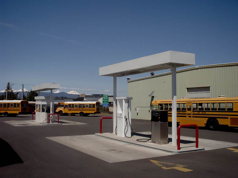 The school district installed two private stations to accommodate the alternatively fueled buses. Their first station is located at the busier Bend yard (shown) with two autogas dispensers and two 2,000-gallon aboveground tanks.  At their La Pine yard, they installed a 2,000-gallon aboveground tank and single dispenser, which can fuel one bus at a time.