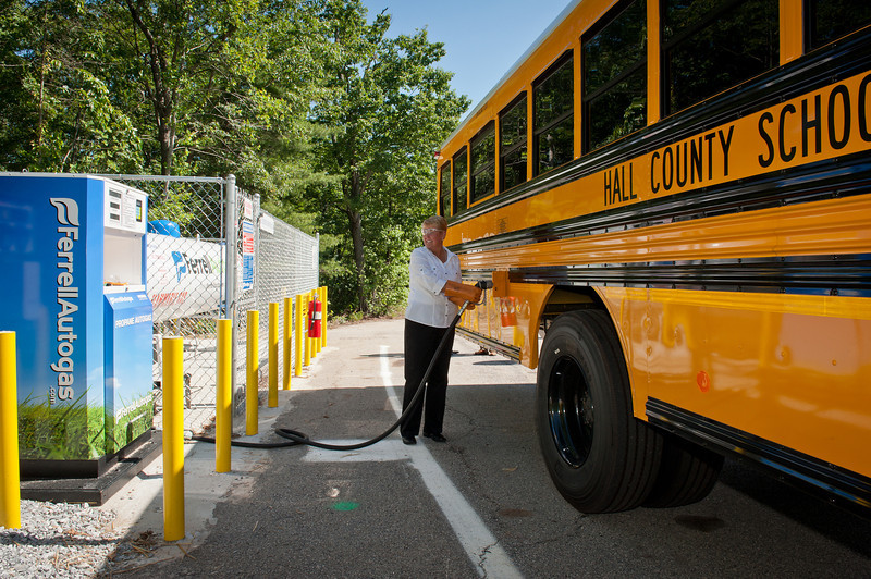 A Hall County bus driver refuels with propane autogas. Hall County is the first school district in Georgia to use clean, domestic and economical propane autogas. ROUSH CleanTech manufacturers the propane autogas fuel system on the Blue Bird buses.