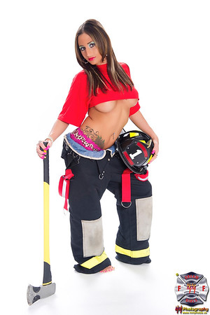 Sexy brunet female firefighter glamour