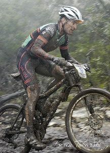 Jason Sager at the muddy 2005 NORBA Nationals opener at Tapatio Springs. This photo made the cover of The Racing Post. I had a hard time getting pictures from this spot without falling over and getting covered in mud from the riders going by. Some of the pros made it look easy, but those mud covered rocks were difficult just to walk on. This photo was published on the April 2005 cover of The Racing Post.