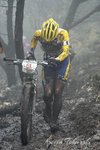 """This photo captures the spirit of the weekend at the very muddy 2005 NORBA Nationals opener at Tapatio Springs. The Racing Post titled this photo """"A Day at the Office"""" which would probably be considered a very bad day at the office by this professional mountainbike racer."""