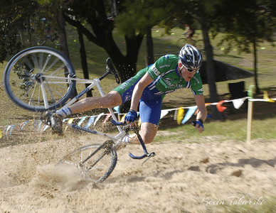 The sandpit at the GCCA/Bikesport Cyclocross Race sends Kevin Koen over the bars to a soft but sandy landing.
