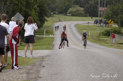 KJT_2007-05-06_0025 Ivan Mukasa 1989 - 2007. After this spectacular crash approaching the finish line of the Mineral Wells Cat 3 race, Ivan got right up to run to the finish line.