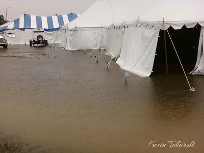 This photo was sent to us by one of our Team Pate crew members Steve Zettlemoyer at the La Grange fairgrounds Friday afternoon. Other reports from La Grange crew members included 1 foot of standing water in some of the tents and tent stakes coming out of the muddy ground. Keep in mind some of these tents are 20' x 30' and larger.