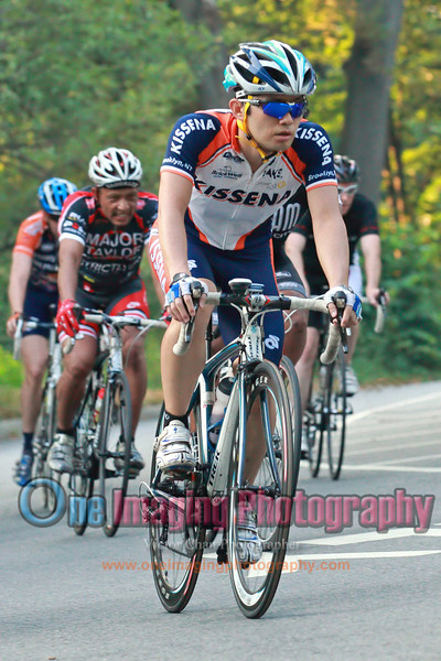 The rest of the riders coming through off the hill.<br />  Lucarelli & Castaldi Cup race 7/23/11 > Cat 4