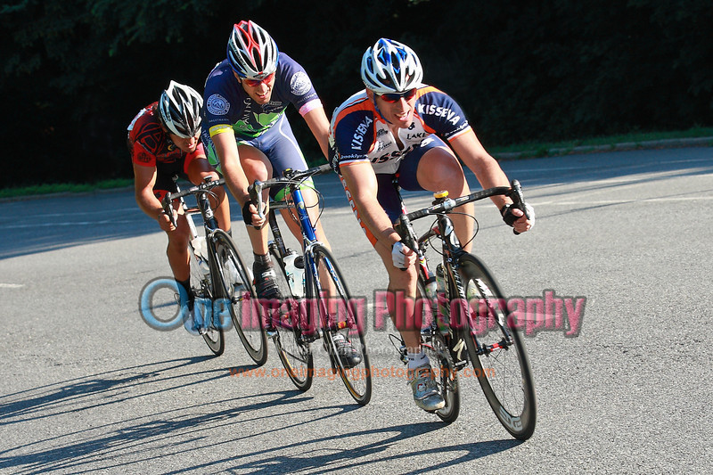 A small chase group late in the race, off the downhill section.<br />  Mangoseed Restaurant-WS United Race 7/31/11 > Cat 3