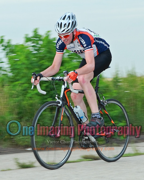 Josh with the field.  Lap 7.<br />  Team United Thursday Night Race 7/28/11 > Cat 3 and 4