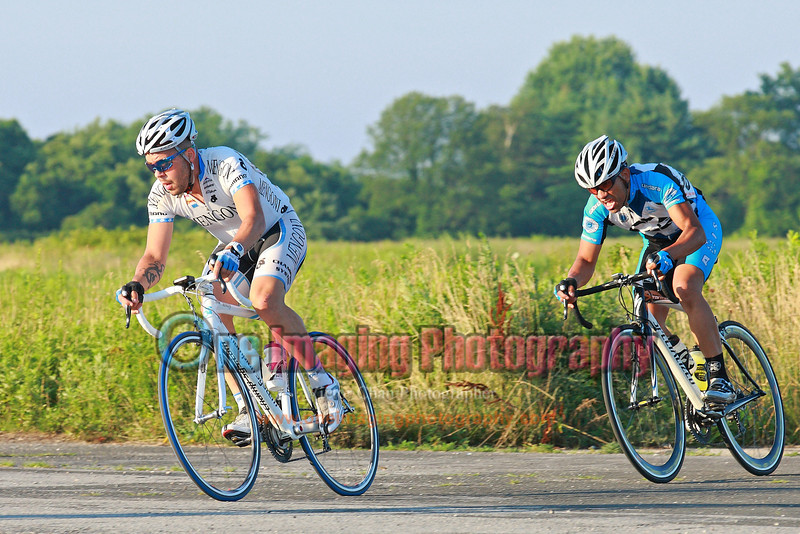 Brian and Dan off turn 4th, lap 2.<br /> Tuesday Night Race at FBF 7/5/11 > Pro 123
