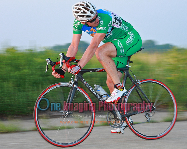 Checking his winning margin.<br />  Tuesday Night Race at FBF 7/20/11 > Cat 3 and 4