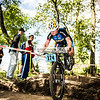Catherine Hollibaugh kept it upright and kept on pedaling after this nose-wheelie! ; 2014_MTB_Marian-5244