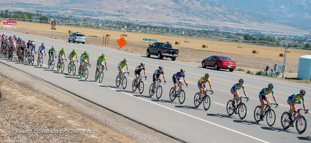 the peloton strings out heading for the 1st sprint point