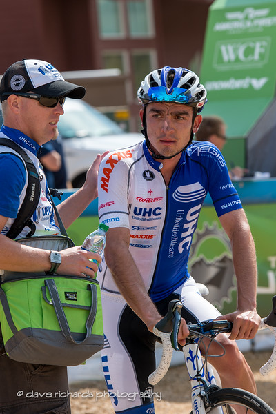 soigneur assists a spent rider