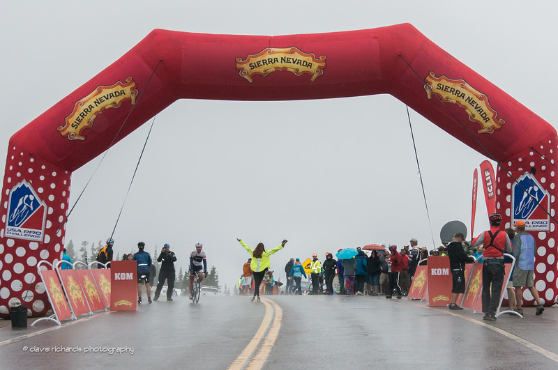 a fan awaits the riders on the fog shrouded, rain soaked Hoosier Pass KOM, Stage 5, 2014 USA Pro Challenge