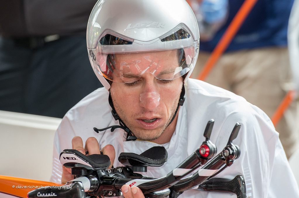 A rider dials in his computer as he awaits his start of the Vail Time Trial, Stage 6, 2014 USA Pro Challenge