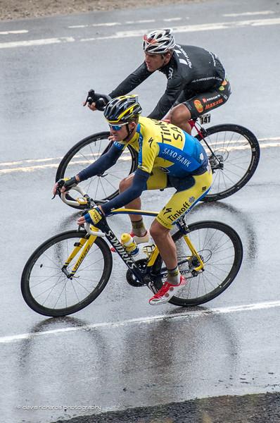 Mick Rogers (Tinkoff Saxo) & Sergei Tvetcov (Optum) negotiate a tight turn in the rain, Stage 5, 2014 USA Pro Challenge