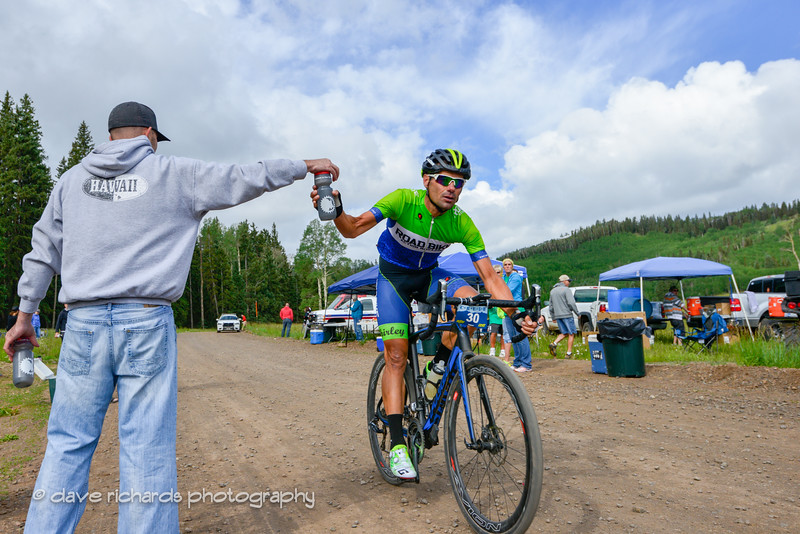 neil shirley takes a fresh bottle at aid station #2