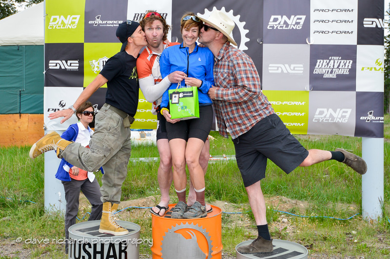 obligatory kiss from the podium guys for the Tandem Class winning team of Amy Andrews and Stephen Wasmund