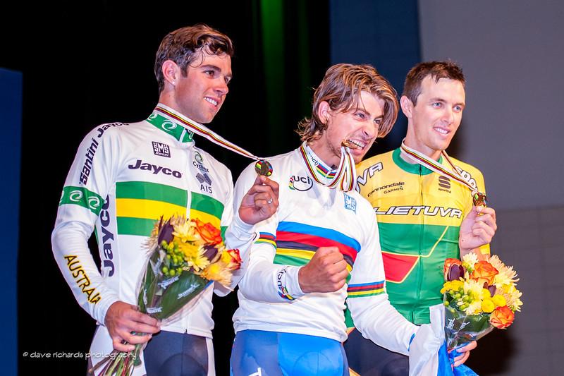 "Peter ""the Hulk"" Sagan (Slovakia) gold medal winner on the podium with silver medal winner Matthews (Australia) & bronze medal winner Navardauskas (Lithuania),  Elite Men's Road Race, 2015 UCI World Cycling Championships. daverphoto.com"