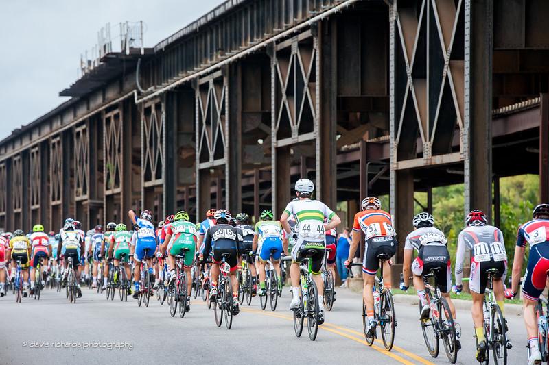 Elevated train tracks overshadow the peloton along Dock Street, U23 Men's Road Race, 2015 UCI World Championships