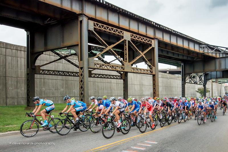 the peloton races along the elevated train tracks on Dock Street, U23 Men's Road Race, 2015 UCI World Championships