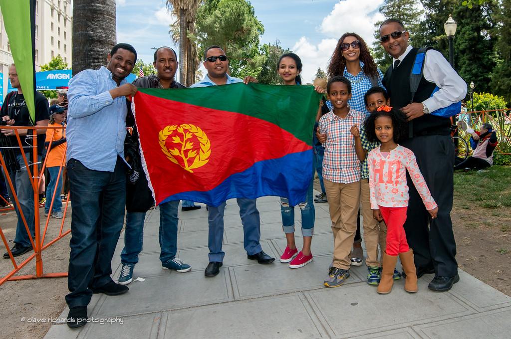 Eritrean fans hoist the country's flag in honor of Daniel Teklehaimanot (Dimension Data)