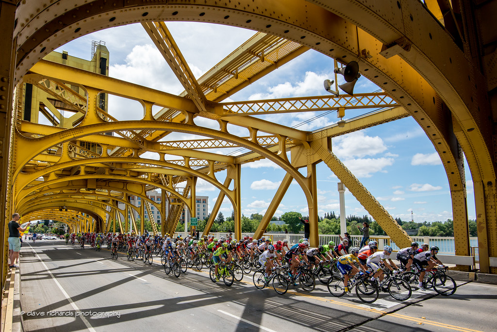 the peloton rolls out under the historic Tower Bridge for the start of Stage 8, 2016 Amgen Tour of California