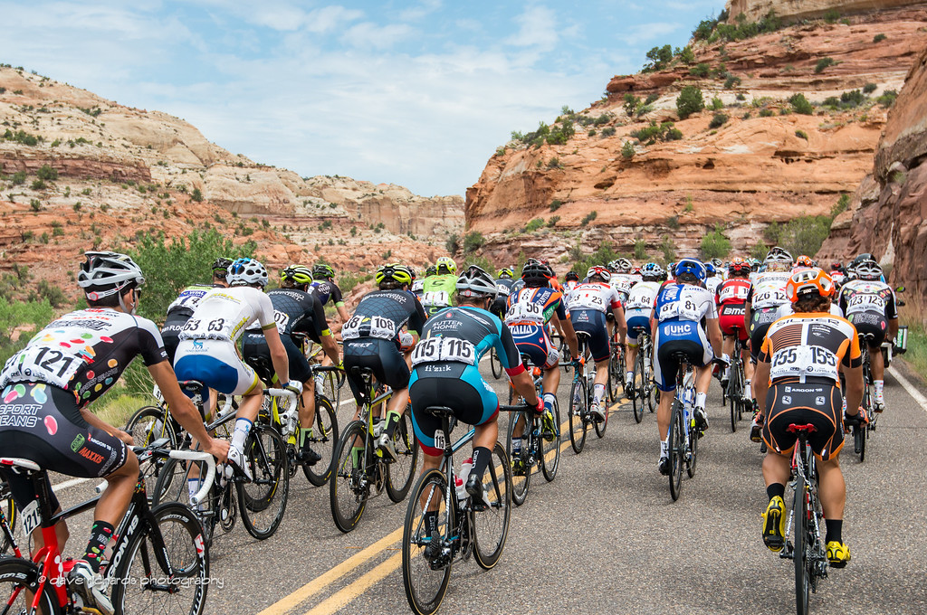 the riders pass thru the rock formations along Calf Creek Falls, Stage 2, 2016 Tour of Utah