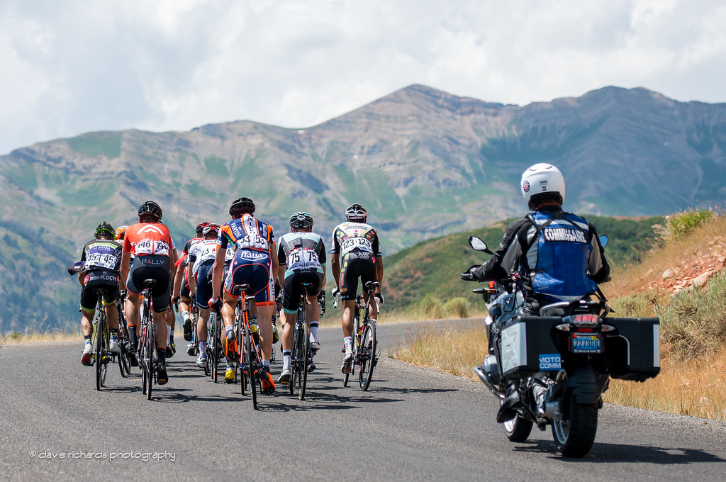 a small group of riders under the watchful eye of the moto commissaire, Stage 3, 2016 Tour of Utah