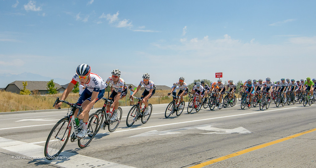 the peloton leaning into the turnaround on Mountain View Corridor Hwy, Stage 4, 2016 Tour of Utah