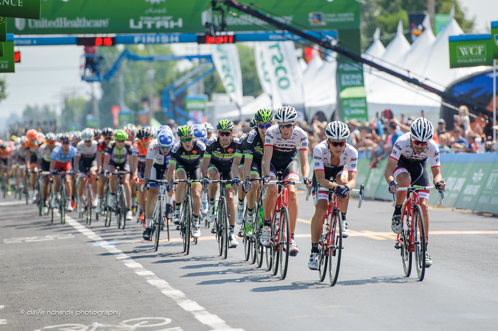 the peloton passes thru the finish line on the 1st of three final circuits, Stage 4, 2016 Tour of Utah