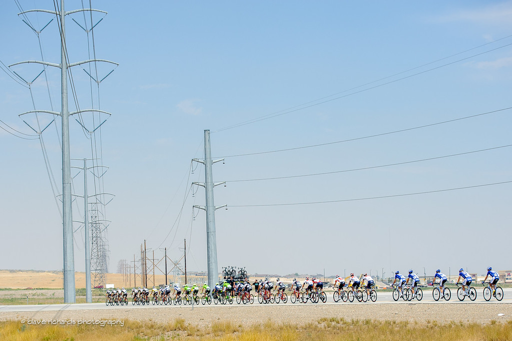 riders are dwarfed by high voltage power lines during Stage 4, 2016 Tour of Utah