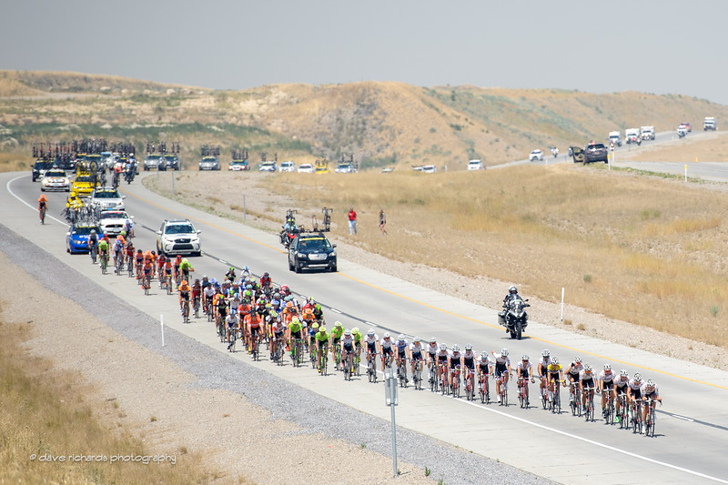 the peloton and caravan rolls down one of many short hills during Stage 4, 2016 Tour of Utah