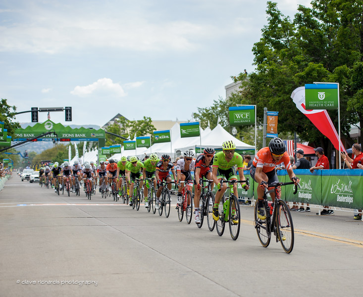 the peloton rolls thru the finish line on the first of two circuits in downtown Bountiful, Utah  on Stage 5, 2016 Tour of Utah